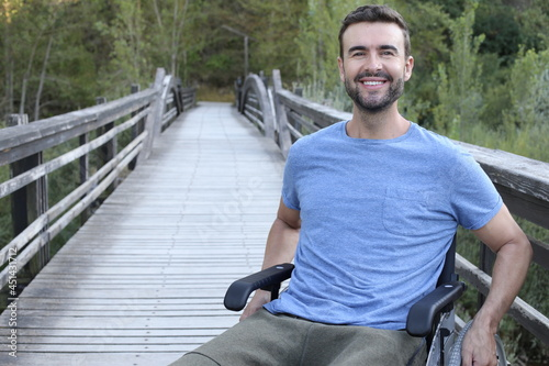 Foto Young handsome man on a wheelchair