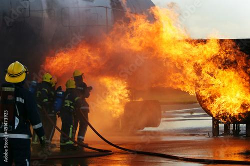 jet aircraft fire, airport fire crew fighting craft engine fire Fototapet