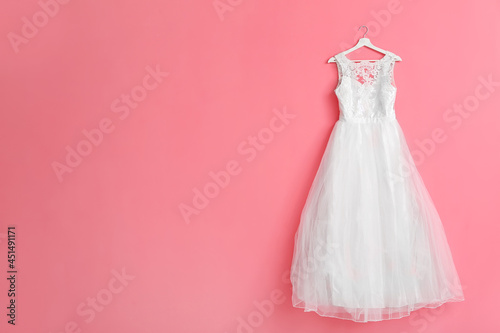 Canvas Beautiful wedding dress on color background