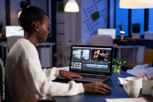 Obraz na plátně African american video editor working late at night at digital movie project editing audio film montage in in creativity start-up business office