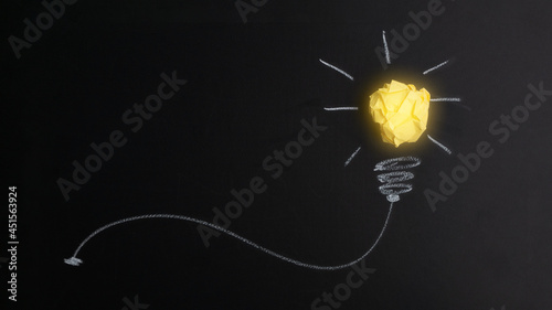 Great idea concept with crumpled yellow paper light bulb isolated on dark background.Creative idea. Concept of the idea, innovation, and Inspiration.