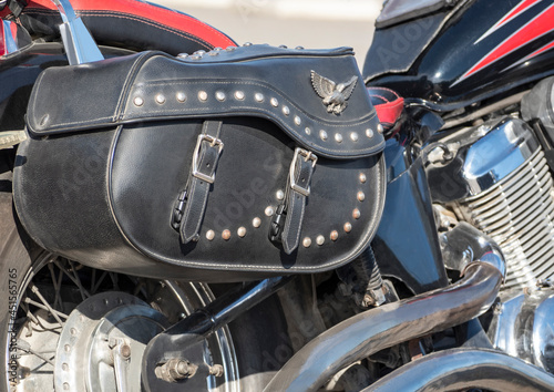 Canvas Closeup of leather motorcycle chopper bag with studs