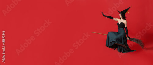 Vászonkép Beautiful woman dressed as witch for Halloween on color background with space fo