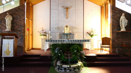 Foto shot of religious Christian or catholic chapel and altar for worshippers