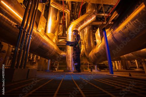 Fotografie, Obraz Male to be worker visual inspection inside control room valve tank pipeline