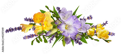 Fotografia Purple and yellow freesia flowers with lavender in a line floral arrangement iso