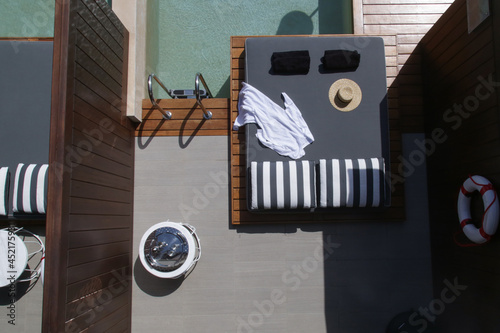 Top view of luxury sunbed nearby swimming pool. Poster Mural XXL