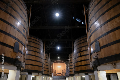 Old porto lodge with rows of oak wooden casks for slow aging of fortified ruby o Fototapet