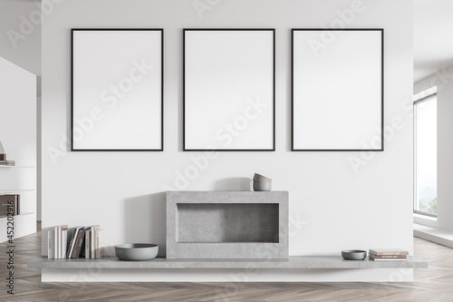 Three posters on the white and grey living room wall with fireplace Fototapet