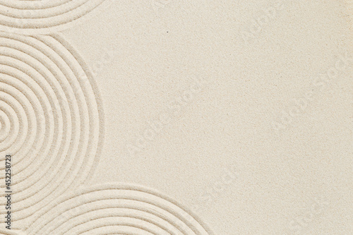 Fototapeta Lines drawing on sand, beautiful sandy texture