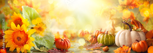 Festive autumn decor from pumpkins, flowers and fall leaves. Concept of Thanksgiving day or Halloween #452333361