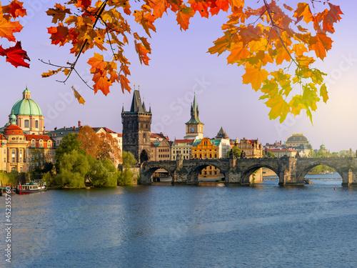 Fototapeta Prague cityscape with Charles bridge over Vltava river in autumn sunset, Czech R