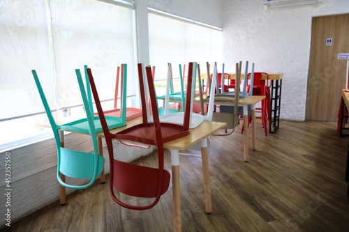 Tableau sur Toile Colorful chair tun on table stop service during corona virus disease
