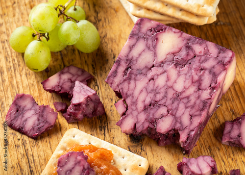 Canvas Creamy port wine derby cheese on wooden board with grapes and chutney
