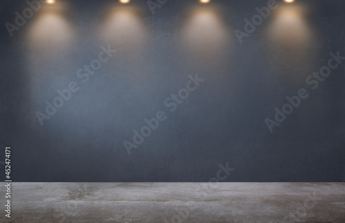 Leinwand Poster Dark gray wall with a row of spotlights in an empty room