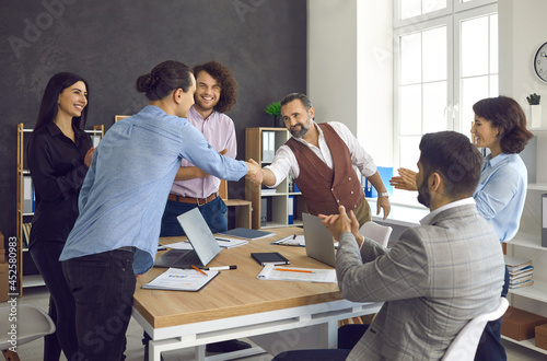 Business people exchanging a handshake, confirming collaboration and thanking each other for help Fototapeta
