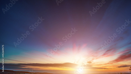 Panoramic sunrise over a green field