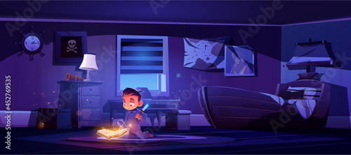 Fotografia Little boy practice magic with wand and glowing spell book, magician child conjure in bedroom night interior with pirate ship bed