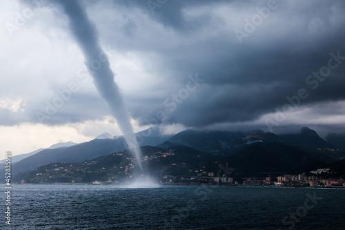 Obraz na plátně Tornado in the sea near the shore