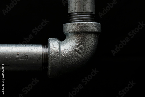Photo Metal elbow  cruz tees for water pipes hierro maleable acero al carbon
