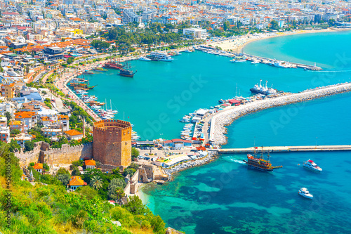 Fototapeta Panoramic view of the harbor of Alanya on a beautiful summer day