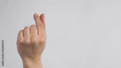 Fotografija Right Hand is doing mini heart hand sign on white background.