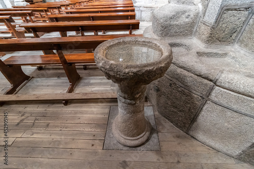 Classic baptismal font, made of a stone of granite, used for baptism in a europe Fototapet