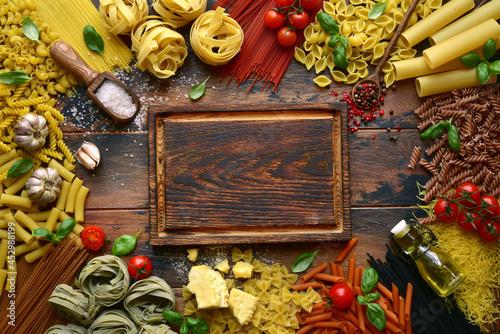 Obraz na płótnie Assortment of raw organic italian pasta with ingredients for making