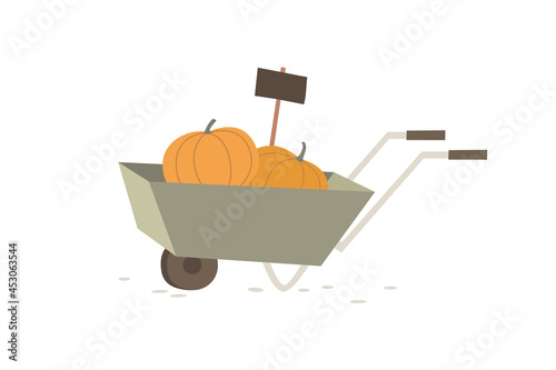 Canvas-taulu Garden wheelbarrow with two ripe pumpkins and a label on a light isolated background
