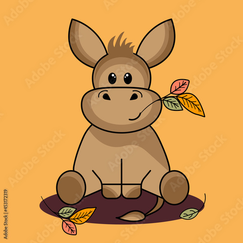 Fototapeta Cute funny eeyore donkey on an autumn background with leaves