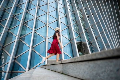 Asian woman in red dress at modern building, female girl with urban city lifesty Fototapet