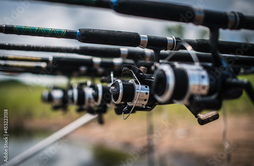 Canvastavla Fishing rods are lined up by the lake to wait for fish to eat bait at Nong Klang