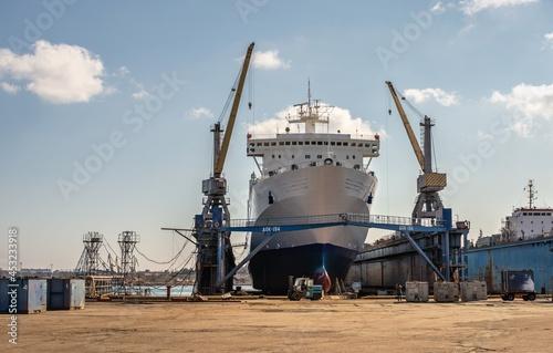 Fototapeta Large ship in dry dock of shipyard