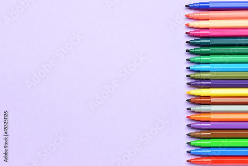 Obraz na plátně Colorful markers on color background