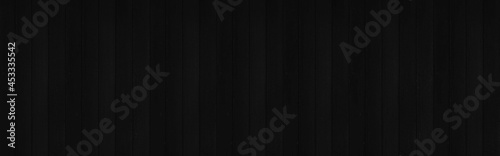 Stampa su Tela Panorama of Black vertical Wooden Wall Texture Background, Top-down of table woo