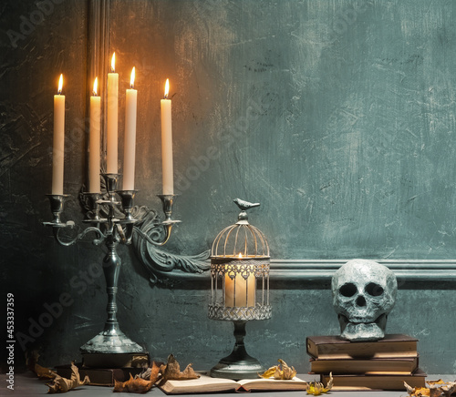 Fotografie, Obraz Scary laughing pumpkin and old skull on ancient gothic fireplace