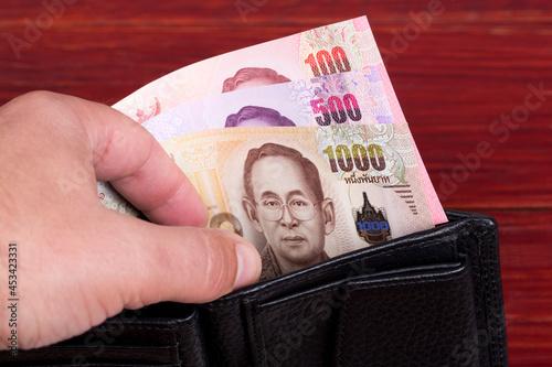 Fotografija Thai money - baht in the black wallet