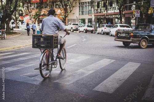 Slika na platnu Man riding a bicycle