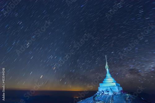 Billede på lærred Beautiful night landscape The colorful star trails on the sky