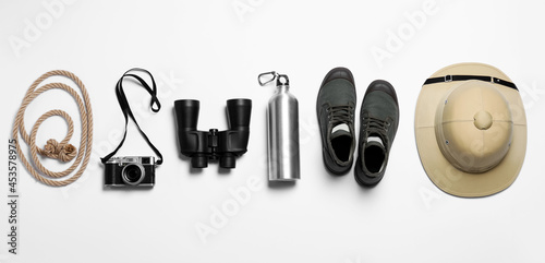 Obraz na plátne Flat lay composition with different safari accessories on white background