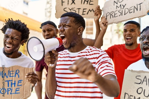 Canvastavla Group of young african american activists protesting holding banner and using megaphone at the city