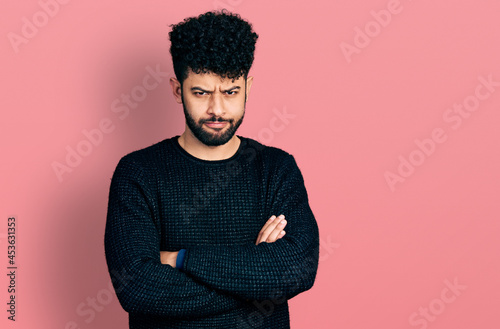 Obraz na plátně Young arab man with beard with arms crossed gesture skeptic and nervous, frowning upset because of problem