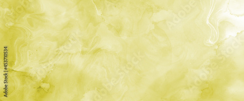 Foto Yellow wet watercolor liquid paint splash texture on white background design