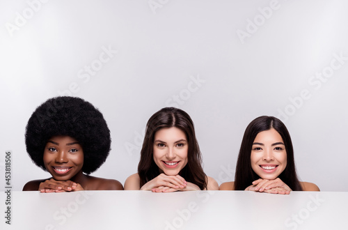 Stampa su Tela Photo of three young attractive girls happy positive smile hands touch chin drea