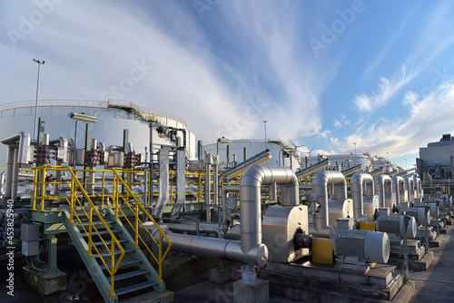 pipelines and buildings of a refinery - industrial plant for fuel production Fototapet