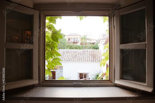 View of courtyard through window Fotobehang