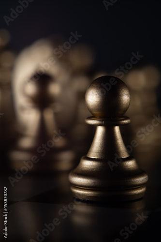 Vertical shot of a chess pawn on the board on a blurred background Fototapet