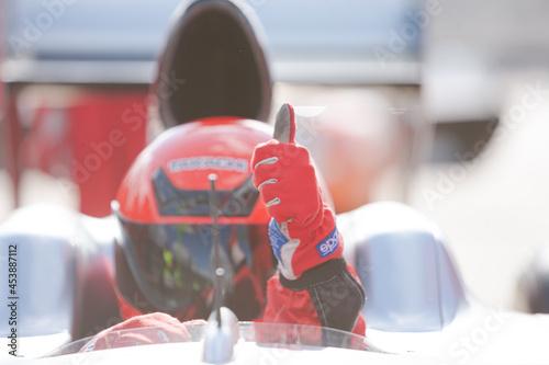 Fototapeta Close up of racer wearing helmet