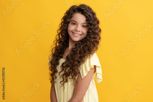 cheerful child with long curly hair and perfect skin, healthy hair Fotobehang
