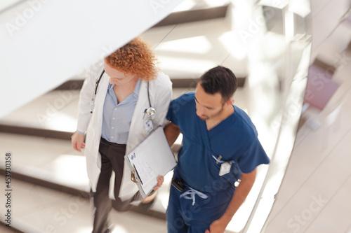 Doctor and nurse walking on hospital steps